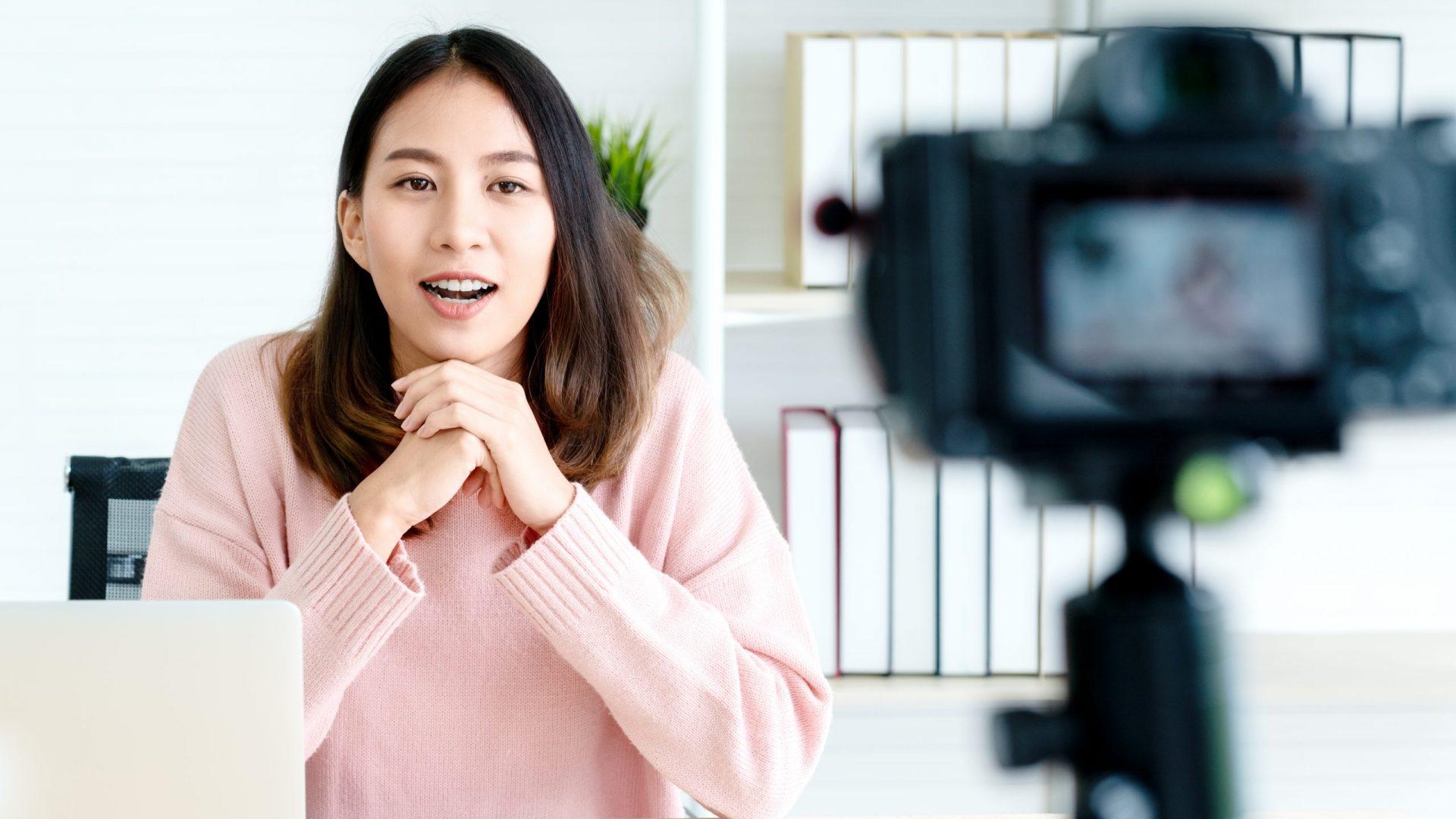 Young,Attractive,Asian,Woman,Blogger,Or,Vlogger,Looking,At,Camera