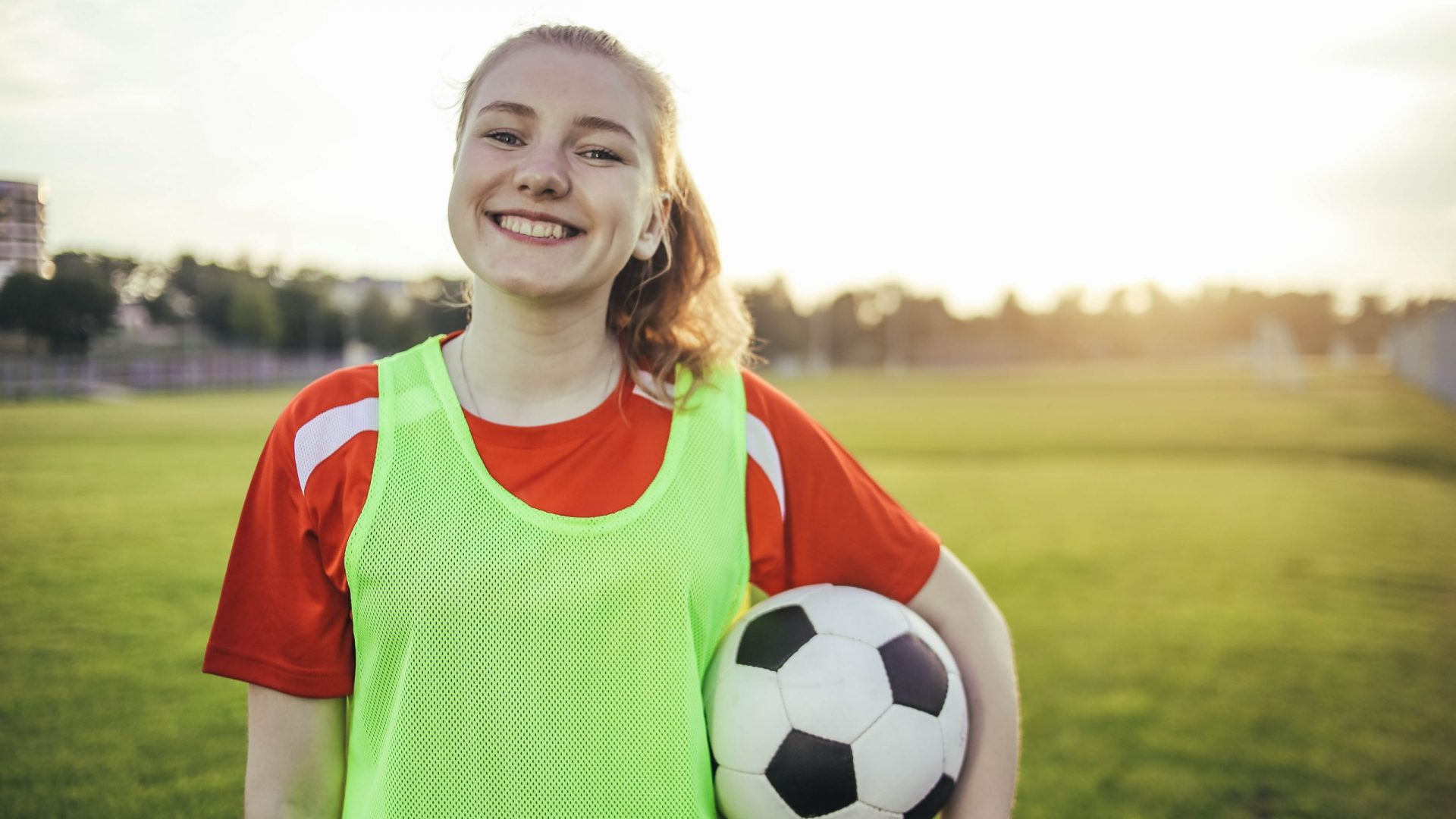 Portrait,Of,A,Smiling,Teen,Girl,Football,Player,With,A