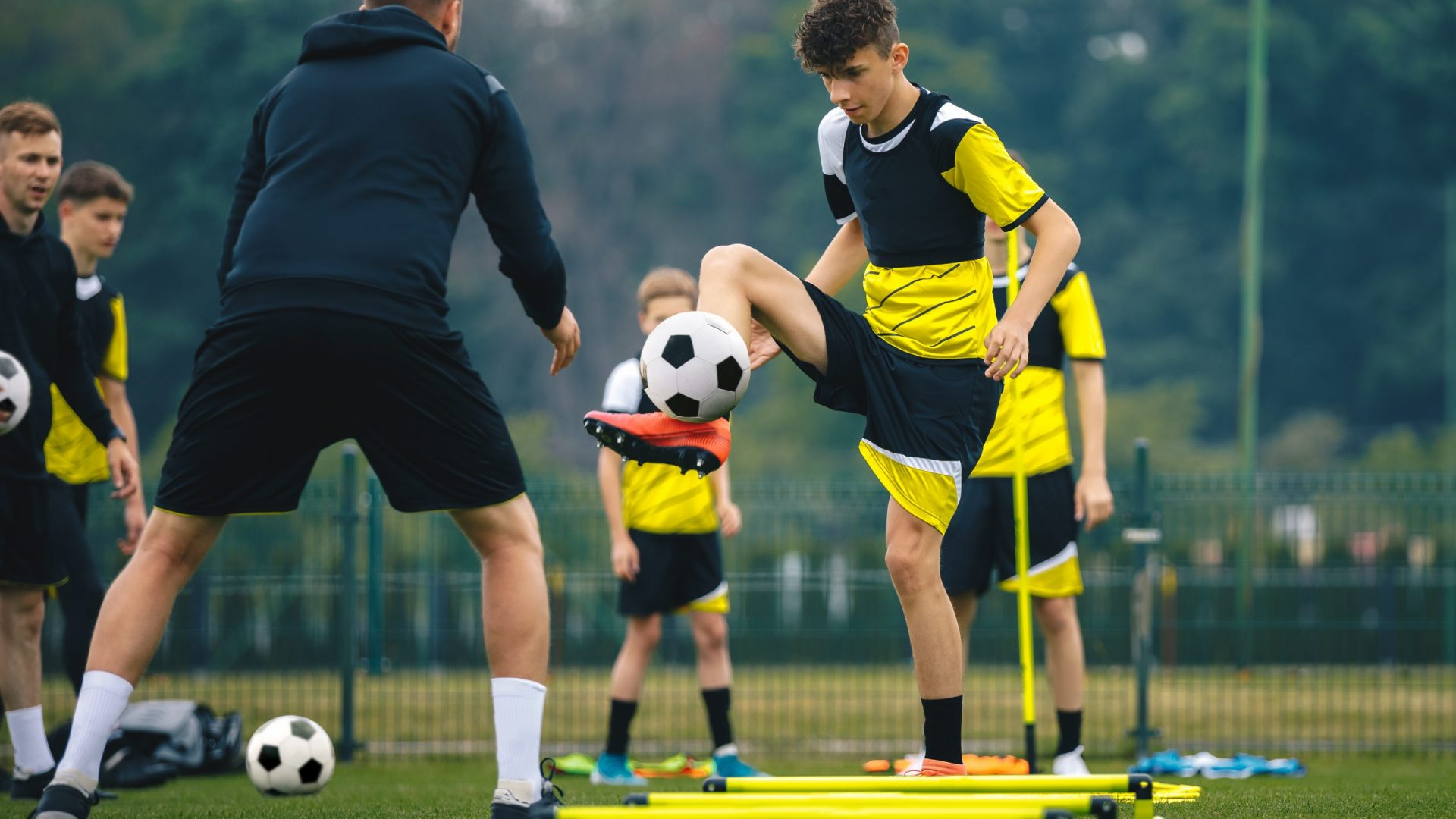 Teenagers,On,Soccer,Training,Camp.,Boys,Practice,Football,With,Young